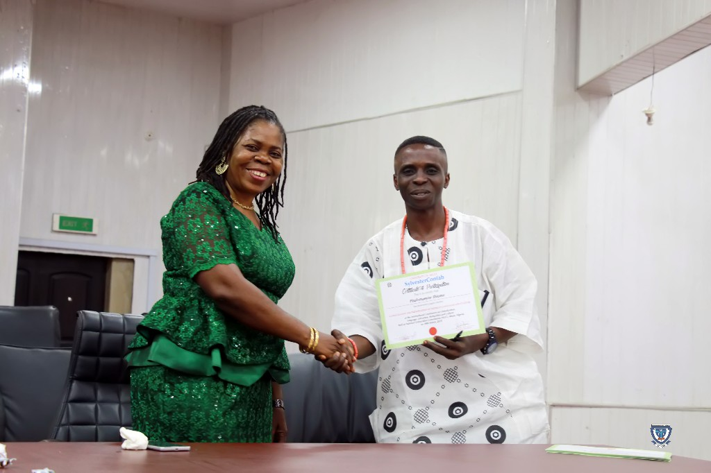 Mr. Paul-Maeyor Ihionu receiving a Certificate for his Paper Presentation at the SylvesterConfab 2019 held in NUC, Abuja