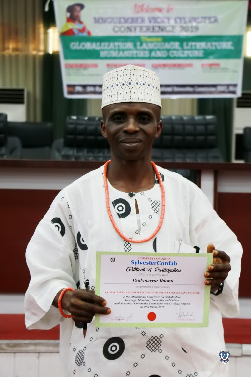 Mr. Paul-Maeyor Ihionu displaying his Certificate of Paper Presentation at the SylvesterConfab 2019
