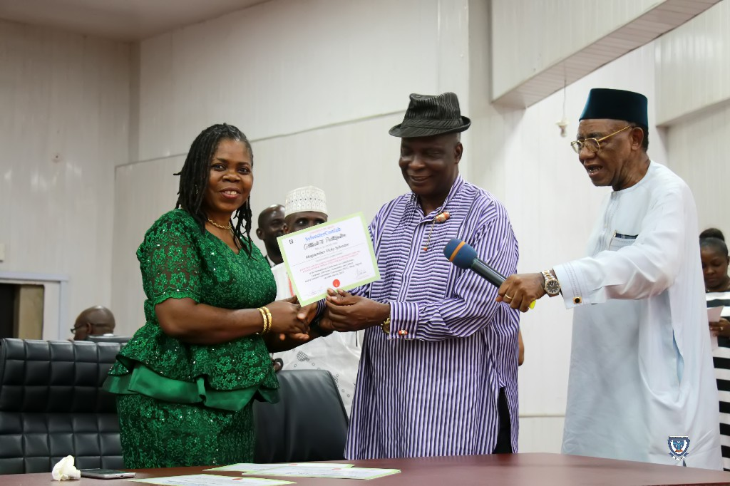 Professor Mnguember Vicky Sylvester (host) receiving a Certificate at the International Conference (SylvesterConfab 2019) held in her honour