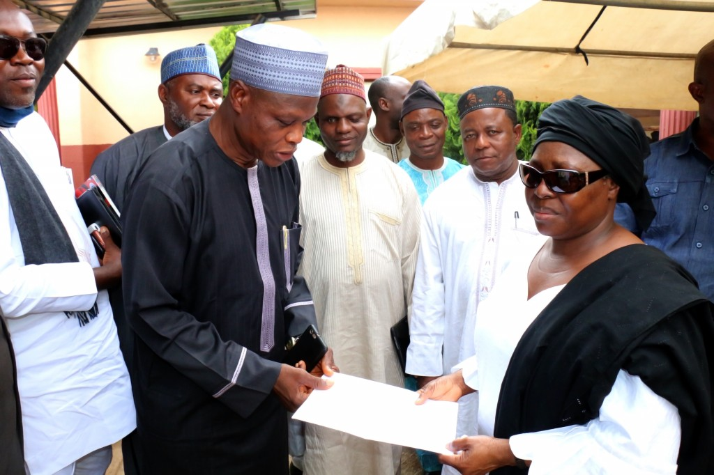 The Registrar, Mr. Usman Suleman Obansa presenting condolence letter on behalf of the University Management to the Vice-Chancellor, Professor Angela F. Miri at the deceased residence in Jos